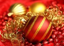 Brinquedos vermelhos e amarelos do Natal Imagens de Stock Royalty Free