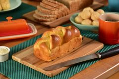 Brioche bread on rustic board Royalty Free Stock Images