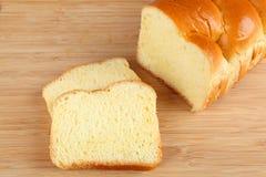 Brioche. Broiche bread on cutting board Royalty Free Stock Photo