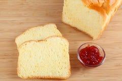 Brioche. Broiche bread with red jam Royalty Free Stock Image