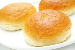 Brioche buns on plate Stock Images