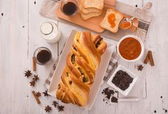 Brioche with chocolate chips. Stock Photos