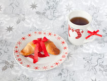 Brioche in Christmas style. Brioche and cup of tea in Christmas style stock photos