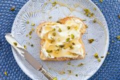 Brioche with cream cheese and honey Stock Photo