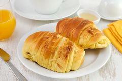 Brioche on the plate with tea Stock Images