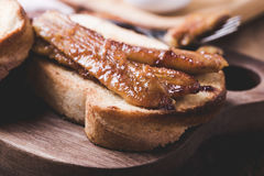 Brioche sandwiches with bananas in caramel sauce Stock Image