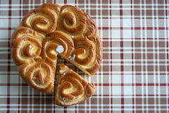 Brioche on tablecloth Royalty Free Stock Images