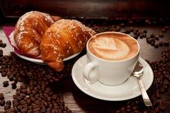 Brioches e cappuccino Stock Image