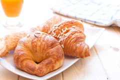 Brioches and orange juice for breakfast Royalty Free Stock Image