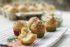 Brioches. In paper cups sprinkled with sesame Royalty Free Stock Photos