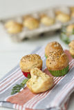 Brioches. In paper cups sprinkled with sesame Stock Images