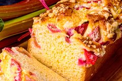 Brioches with rhubarb, strawberry and streusel. A brioches with rhubarb, strawberry and streusel Royalty Free Stock Photos