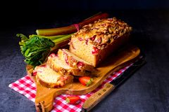 Brioches with rhubarb, strawberry and streusel. A brioches with rhubarb, strawberry and streusel Royalty Free Stock Photography