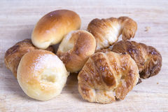 Brioches. On a wood table Stock Photo