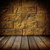 Brique d'or et intérieur en bois Image libre de droits