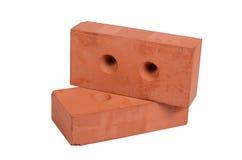 Brique rouge de bâtiment d'isolement sur le blanc Photo stock