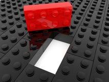 Brique rouge de jouet près de trou entre les rangées des briques noires de jouet illustration libre de droits