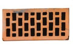 Brique rouge en plan rapproché de profil sur le fond blanc Photo libre de droits