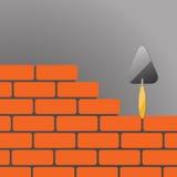 Briques avec la truelle Photos stock