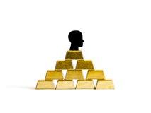 Briques d'or : conceptualisation de richesse d'isolement Image stock