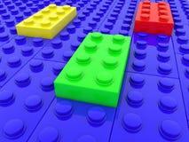 Briques de jouet dans quatre couleurs illustration stock