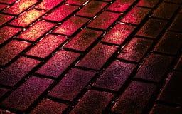 Briques de rue en couleurs Photo stock