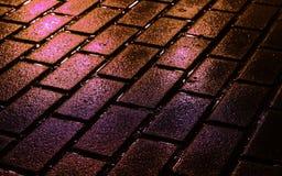 Briques de rue en couleurs Photos stock