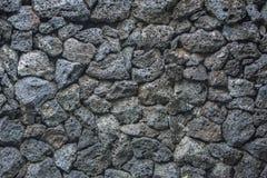Briques en pierre de fond de texture de volcan dans le mur photographie stock libre de droits
