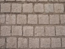 Briques en pierre formées par grand dos colorées grises Photographie stock
