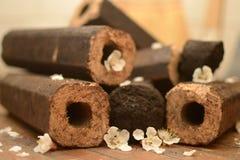 Briqueta marrón octagonal con un agujero Imagen de archivo libre de regalías