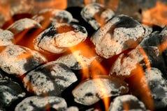 Briquetas ardientes del carbón de leña Foto de archivo libre de regalías