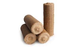 briquetas de madera de la energía del serrín Foto de archivo libre de regalías