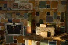 Briquetas de madera en el horno Fotos de archivo libres de regalías