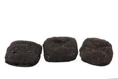 briquets le charbon de bois trois Images libres de droits