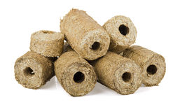 Briquette of straw. Eco briquettes from straw on white background stock photo