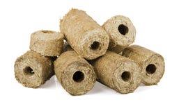 Briquette of straw Stock Photo