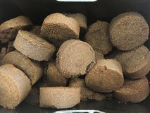 Briquette used coffee grounds. From espresso machine royalty free stock photo