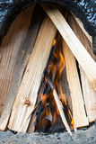Briquettes for ignition among the firewood Royalty Free Stock Image
