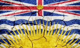 Brirish Columbia, province of Canada, flag. On dry earth ground texture background Royalty Free Stock Image