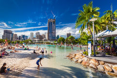 BRISBANE, AUS - APRIL 17 2016: Streets Beach in South Bank Parkl. And. It's inner-city man-made beach next to city center Stock Photo