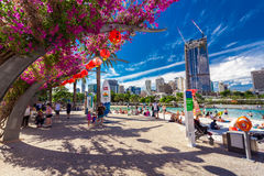 BRISBANE, AUS - APRIL 17 2016: Streets Beach in South Bank Parkl. And. It's inner-city man-made beach next to city center Stock Photos