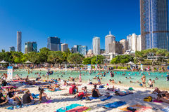 BRISBANE, AUS - DEC 29 2016: Streets Beach in South Bank Parklan. D. It`s inner-city man-made beach next to city center Royalty Free Stock Photography