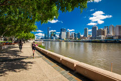 BRISBANE, AUS - NOV 18 2015: River walk in South Bank Parkland. It's inner-city man-made beach next to city center Royalty Free Stock Image