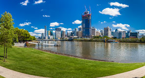 BRISBANE, AUS - NOV 18 2015: River walk in South Bank Parkland. It's inner-city man-made beach next to city center Royalty Free Stock Photo