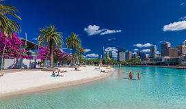 BRISBANE, AUS - NOV 18 2015: Streets Beach in South Bank Parkland. It`s inner-city man-made beach next to city center royalty free stock photo