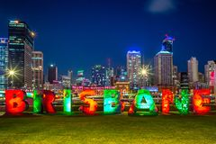 Skyline of brisbane with the g20 Brisbane sign at South Bank. The original BRISBANE sign was commissioned by the Queensland Government for the G20 Leaders` stock photography