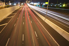 Brisbane, Australia - Wednesday 12th, 2014: Overpass looking onto the Pacific Motorway - M1 with cars travelling at night. Stock Images