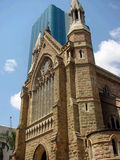 Brisbane cathedral overlapping a modern glass skyscraper Stock Images