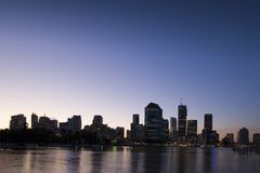 Brisbane city at dusk. Brisbane city skyline at dusk with river in foreground Stock Photos