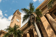 Brisbane City Hall with clock tower and palm trees Royalty Free Stock Images